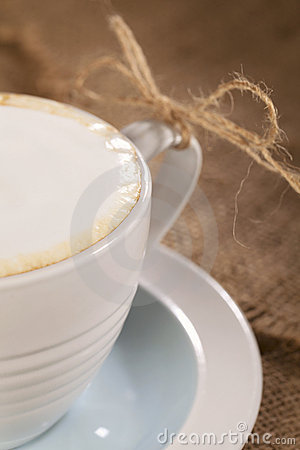 Hot frothy drink cappuccino coffee, rustic style