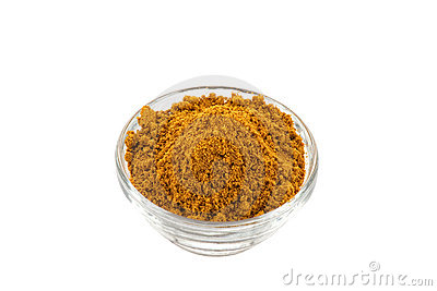 Hot madras curry powder in glass bowl