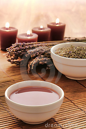 Hot Massage Oil in a Bowl with Lavender in a Spa