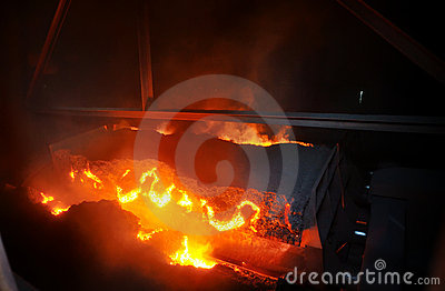 Hot ore on conveyor