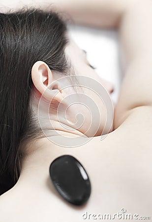 Hot stone massage on the back