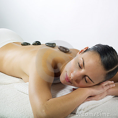 Free Hot Stone Massage In The Day Spa Royalty Free Stock Photo - 7168685