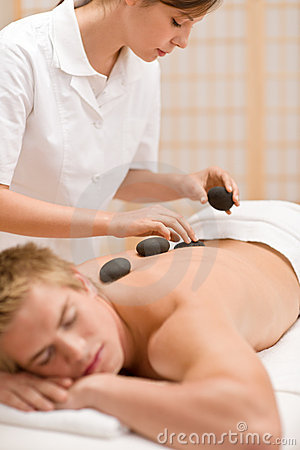 Hot stone massage - man at spa
