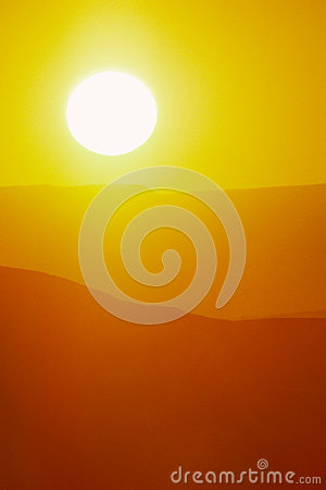 Hot Summer Sunrise with Large Sun and Bright Yellow Sky