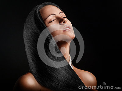 Hot tanned brunette on a black background