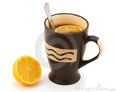 Hot tea with lemon in a black mug