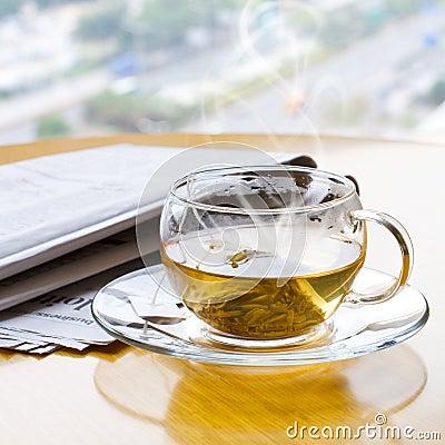 Hot tea and newspaper