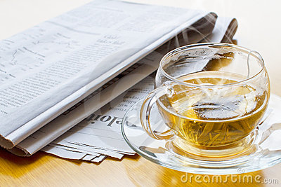 Hot tea and newspaper 2