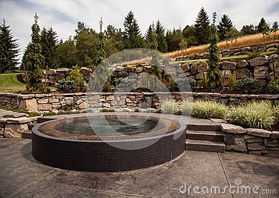 Modern backyard design with custom hot tub