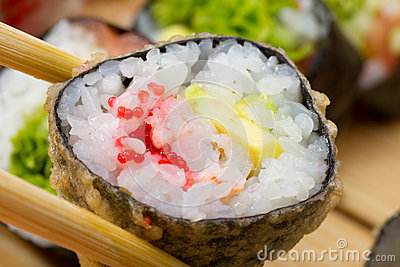 Hot or warm sushi roll takusen in tempura