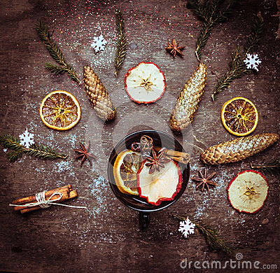 Free Hot Wine Punch In Dark Cup With Winter Spices And Fruits On Wooden Table Royalty Free Stock Photo - 46583595