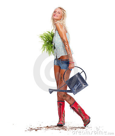 Hot young blond posing as a gardener on white