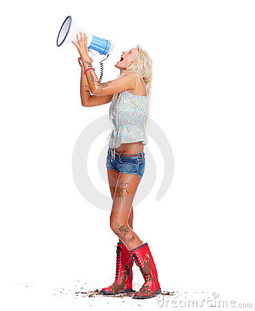Hot young woman in muck yelling into a bullhorn