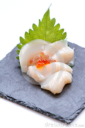 Free Hotate Scallop Sashimi Served With Ikura Salmon Roe And Sliced Radish On The Black Stone Plate Royalty Free Stock Image - 84538856
