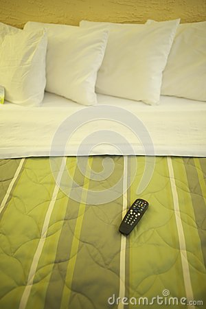 Hotel Bed and TV Remote