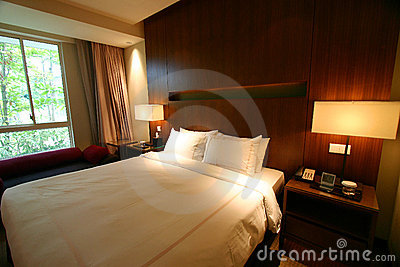Hotel bedroom interior with double bed