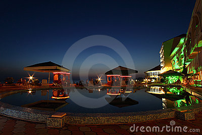 Hotel, cafe and pool in night