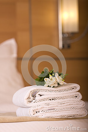 Hotel room bed with white flowers