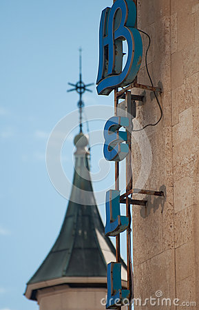 Hotel sign and church tower