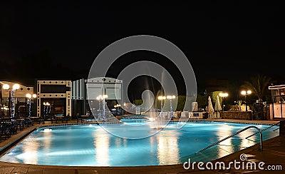 Hotel swimming pool at night