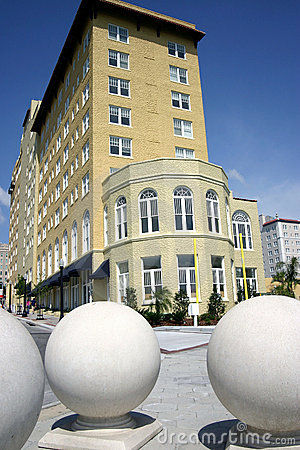 Hotel with three large sphere sculptures in foreground