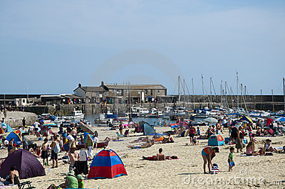 Hottest day of the year .Lyme Regis Beach Editorial Stock Image