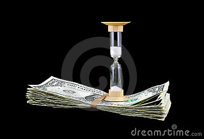 Hour glass atop a stack of cash