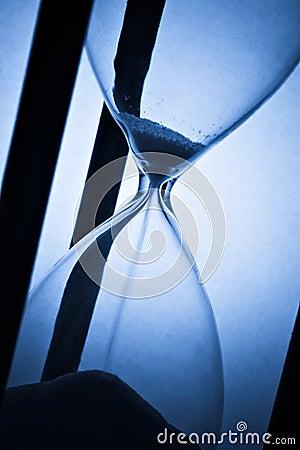 Hourglass on blue