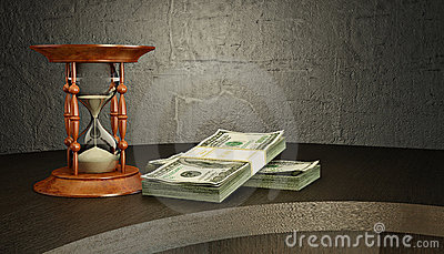 Hourglass and money on the desk