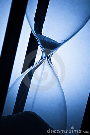 Free Hourglass On Blue Stock Photos - 9955073