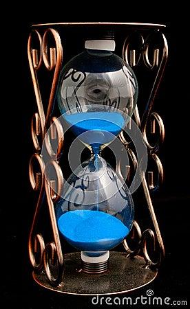 Hourglass with purple sand