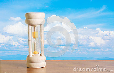 Hourglass with sky background