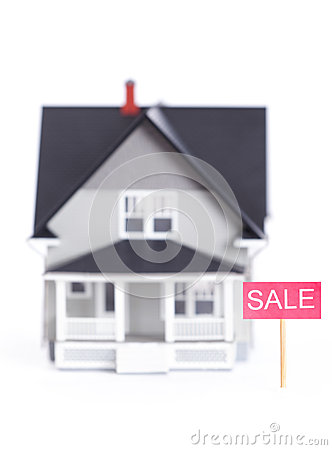 House architectural model with sale sign, isolated