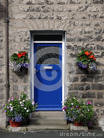 House: blue front door with flowers