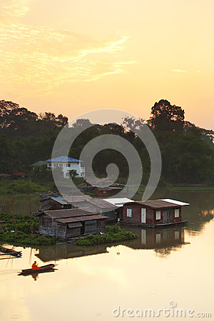 House and boat on river