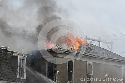 Roof top of house burning