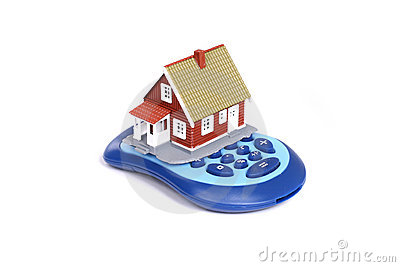 House and calculator over white background.