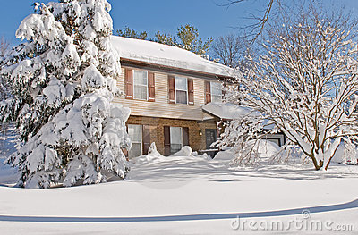 House covered in winter snow