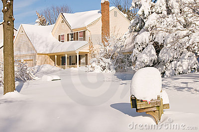 House in deep winter snow