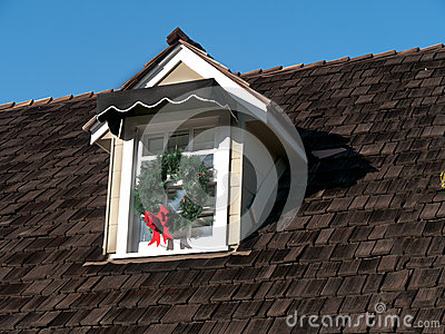 House detail with wooden roof and attic window