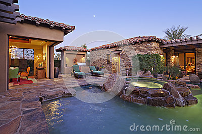 House Exterior with swimming pool and hot tub