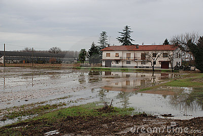 House and Flooded Field Editorial Stock Image