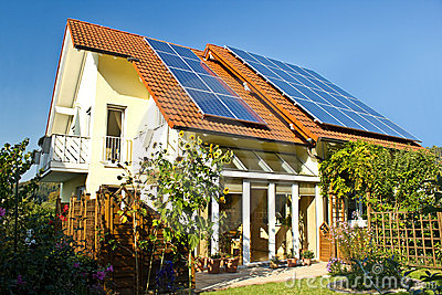 House with garden and solar panels