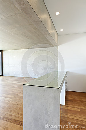 House with hardwood floor, concrete table