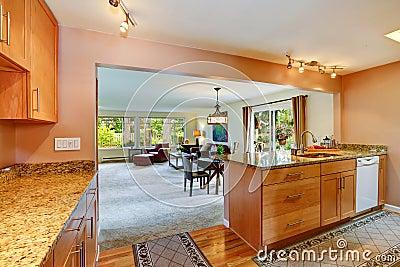 House interior with open floor plan. Kitchen area