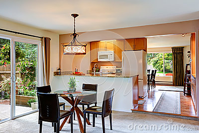 House interior with open floor plan. Kitchen with dining area