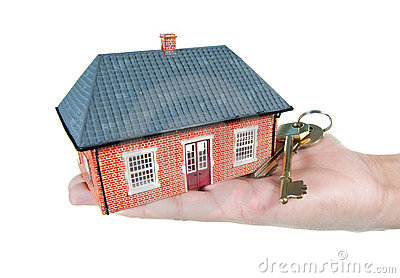 House and keys in a hand