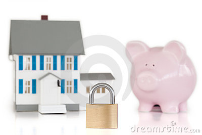 House locked with padlock and piggy bank
