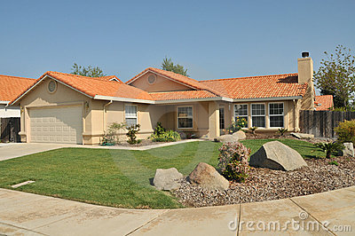 House with long driveway and landscaping