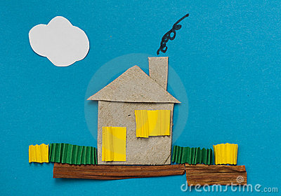 House made of paper over blue paper